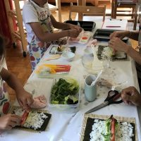 Parent and child sushi-making
